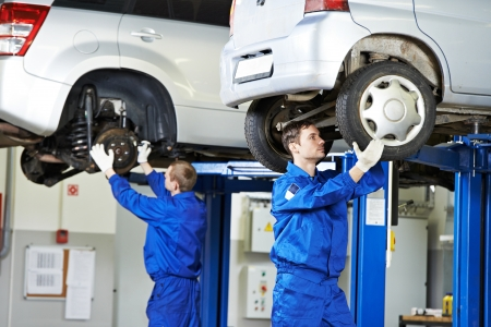 scheduled: auto mechanic at car suspension repair work