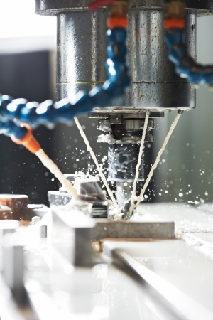 milling the metal blank with coolant Stock Photo - 17825493