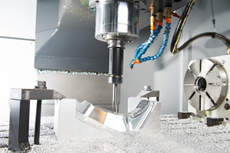 tooling: Close-up process of metal machining by mill Stock Photo