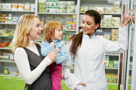 pharmacist: Pharmacy chemist, mother and child in drugstore