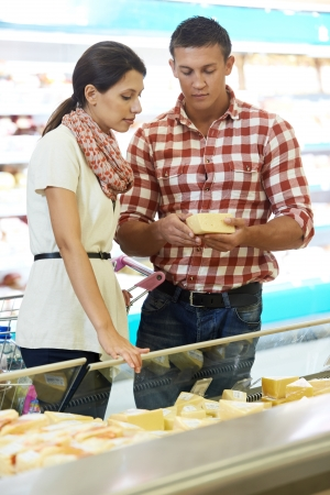 Family choosing food at shopping in supermarket photo