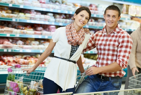 grocery shopping: Family at food shopping in supermarket Stock Photo