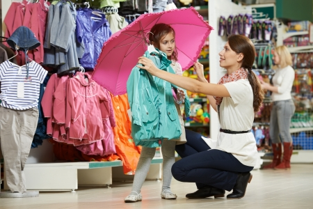 purchaser: woman and little girl shopping clothes