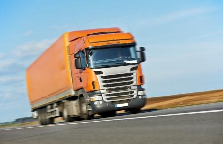 Orange lorry trailer over blue sky photo
