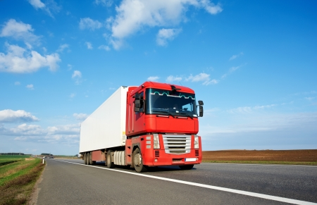 Red lorry trailer over blue sky photo