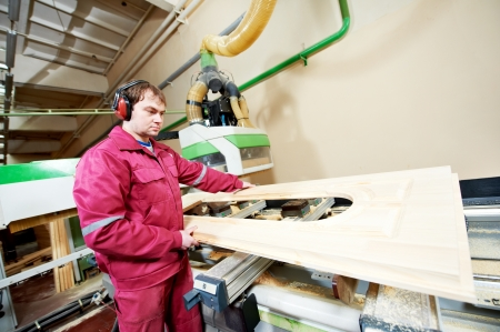 timber cutting: carpentry wood door production Stock Photo