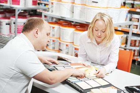 customer assistant: Seller and buyer selecting paint color Stock Photo