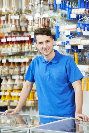 seller: Seller at home improvement store Stock Photo