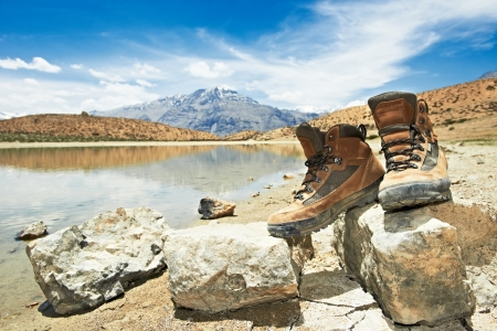 Two tourist traveller hiker shoes boots standing on stones near lake in Himalayas mountains Stock Photo - 18011609