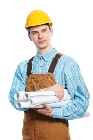 worker in hardhat and overall with drafts photo