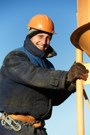 erector: building workers pouring concrete with barrel Stock Photo