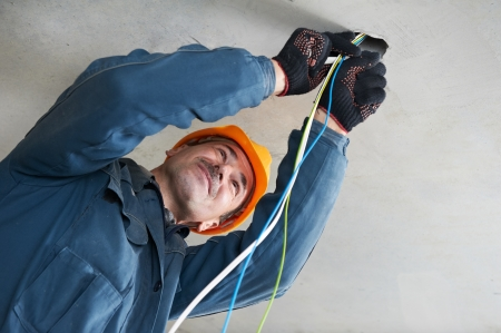 manual test equipment: Electrician at wiring work