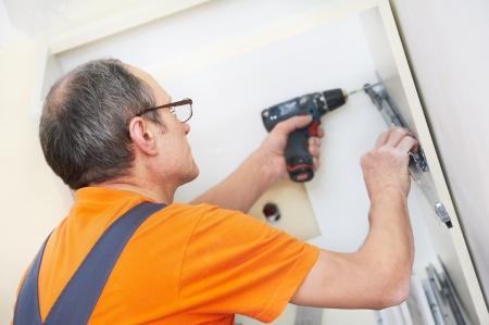 installer: kitchen installer at carpenter work Stock Photo