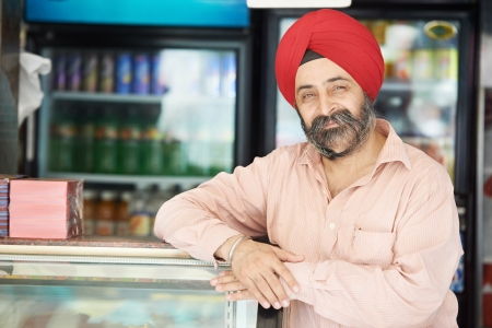 sikh: Young adult indian sikh seller man Stock Photo