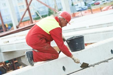 splice: builder worker stop up concrete slab