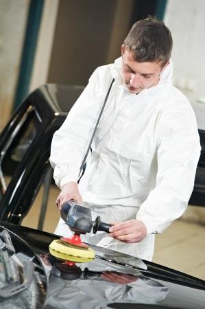 burnish: mechanic repairing and polishing car Stock Photo
