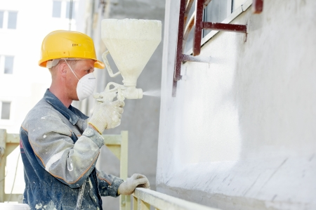 spraying: builder facade plasterer worker Stock Photo