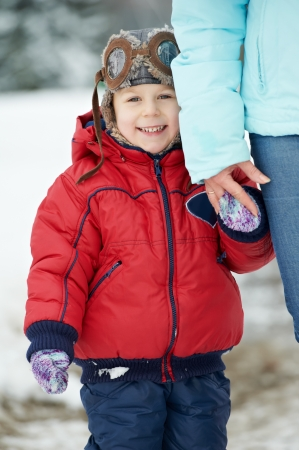 endearment: Happy young child son at winter