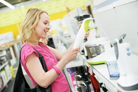 shopper: woman shopping at home appliance supermarket