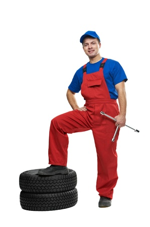 automobile mechanic with car tire and spanner photo