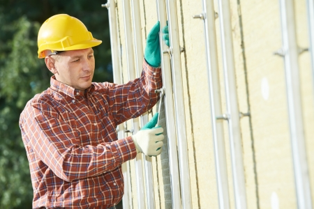 vented: builder at aerated facade tile installation