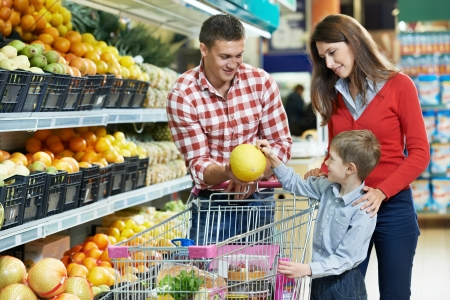grocery shopping: Family with child shopping fruits