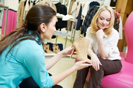 woman and assistant at shoe shopping Stock Photo - 18184477
