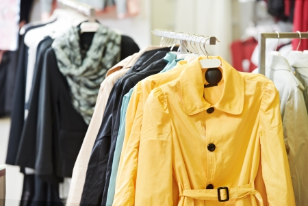 outwear: clothes on hanger in shop Stock Photo