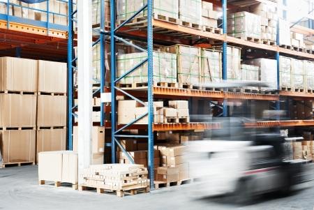 warehouse equipment: worker driver at warehouse forklift loader works