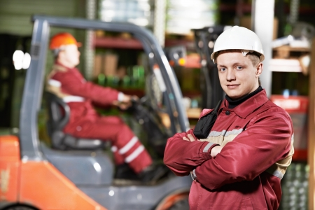 forklift driver: warehouse worker in front of forklift
