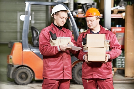warehouse workers in front of forklift Stock Photo - 18196768