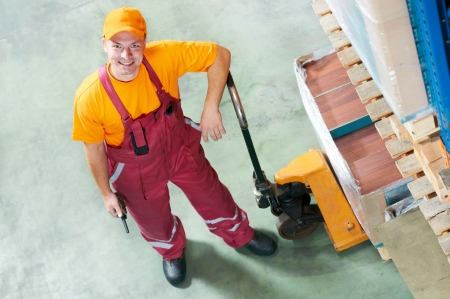 waregouse worker with fork pallet truck Stock Photo - 18196735