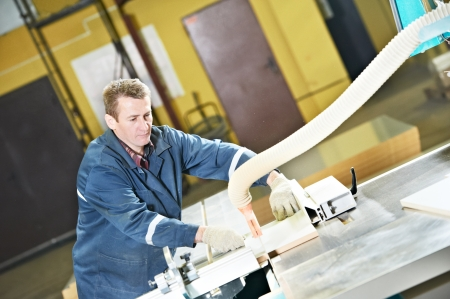 worker at workshop with circ saw