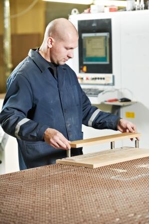 wood furniture worker at workshop photo