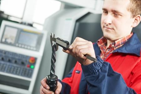 sliding caliper: worker measuring tool by hand caliper