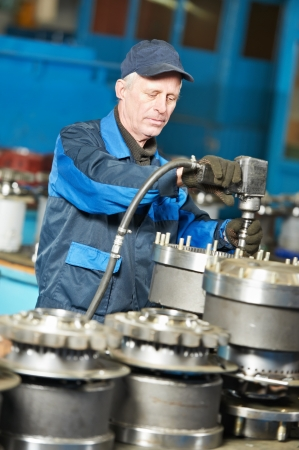 conveyer: experienced industrial assembler worker