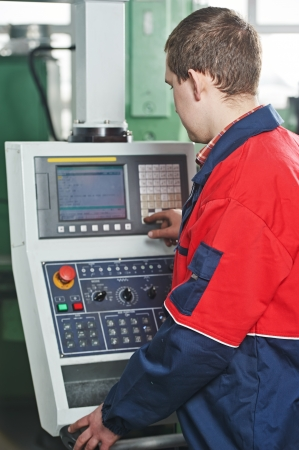 experienced operator: worker at industial manufacture