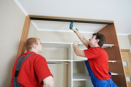 fitting: Wardrobe joiners at installation work
