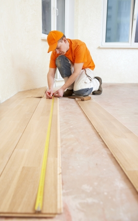 carpenter worker joining parket floor Stock Photo - 18197049