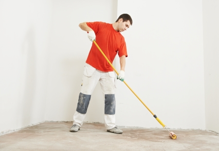 parquet layer with roller priming floor Stock Photo - 18196944