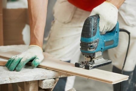 flooring cork: Cutting parquet board with jigsaw Stock Photo
