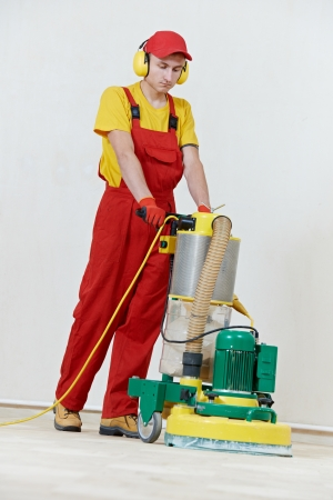 polishing: Parquet Floor maintenance by grinding machine Stock Photo