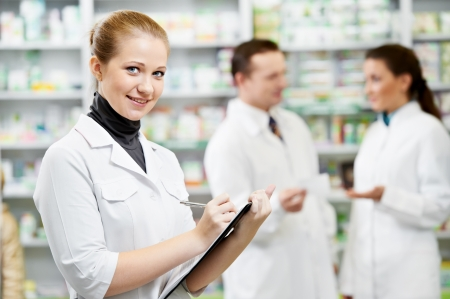 pharmacy store: Pharmacy chemist women in drugstore