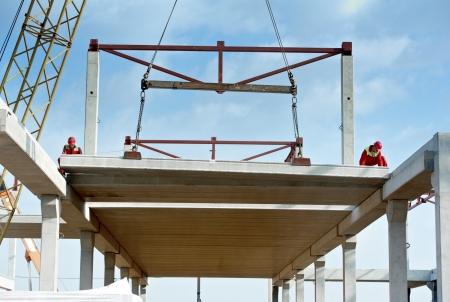 ceiling slab: builder worker installing concrete slab Stock Photo