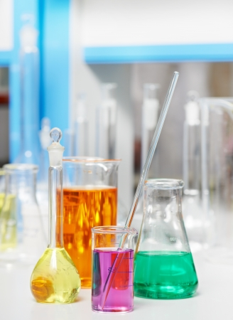 drug test: laboratory flask in chemistry pharmacy research