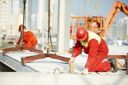 builder worker installing concrete slab Stock Photo