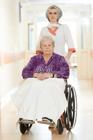 Nurse with elderly patient in wheelchair photo