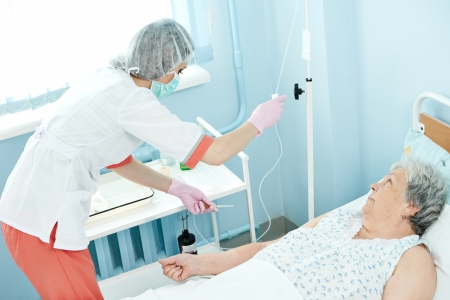 ambulant: nurse preparing dropper for intravenous injection