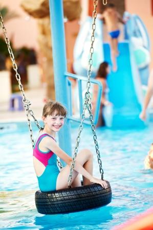 aquapark: Smiling child in resort swimming pool Stock Photo