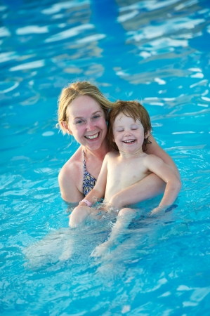 Woman and child in resort swimming pool photo